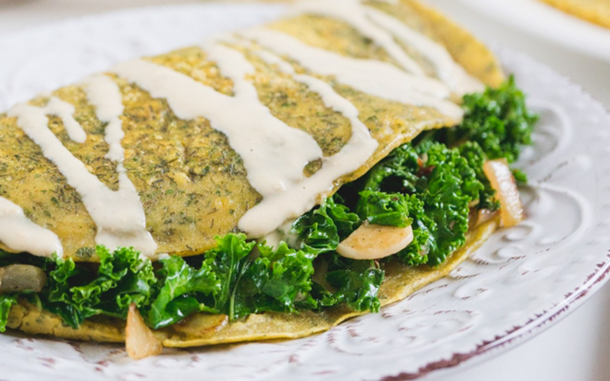 Vegan Chickpea Omelet With Kale Filling And Cheesy Tahini Sauce
