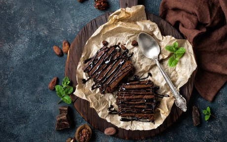 Brownies on a tray with drizzle and garnish