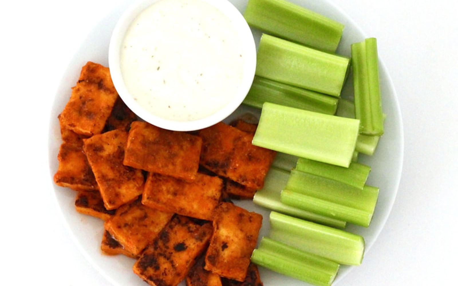 Vegan Gluten-Free Oil-Free Spicy Buffalo Tofu Wings with celery and vegan ranch