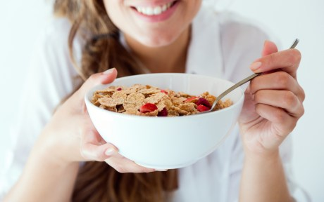 Happy woman with vegan breakfast cereal