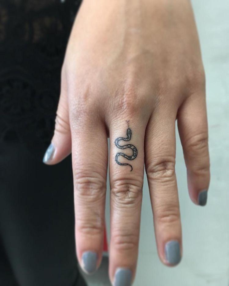 snake tattoo finger