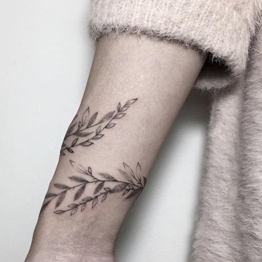 tatoeages van een olijftak