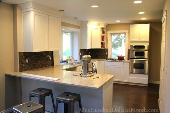white kitchen cupboards dark wood floors