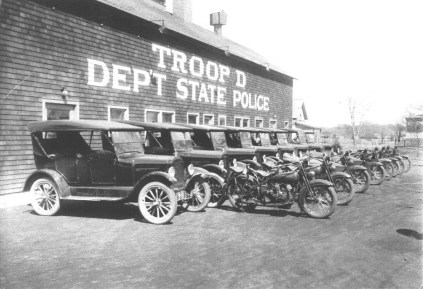 Old Troop D Barracks and Stables (c. 1925) In 1919, Troop D of the New York State Police built its barracks and stables at 240 Genesee Street. By the late 1920s, the stables had been transformed into a garage to house the latest in patrol cars and the troopers' favorite horsepowered vehicle, the motorcycle. The barracks was razed in 1985, but the stables remain as part of Weldon Motor Sales. (Courtesy Madison County Historical Society, #00.1473)
