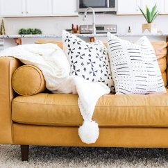 Tan Leather Couch Living Room Examples Why The Sven Sofa Is Perfect For In Your One Article Charme With White Pom Blanket And Black Throw Pillows