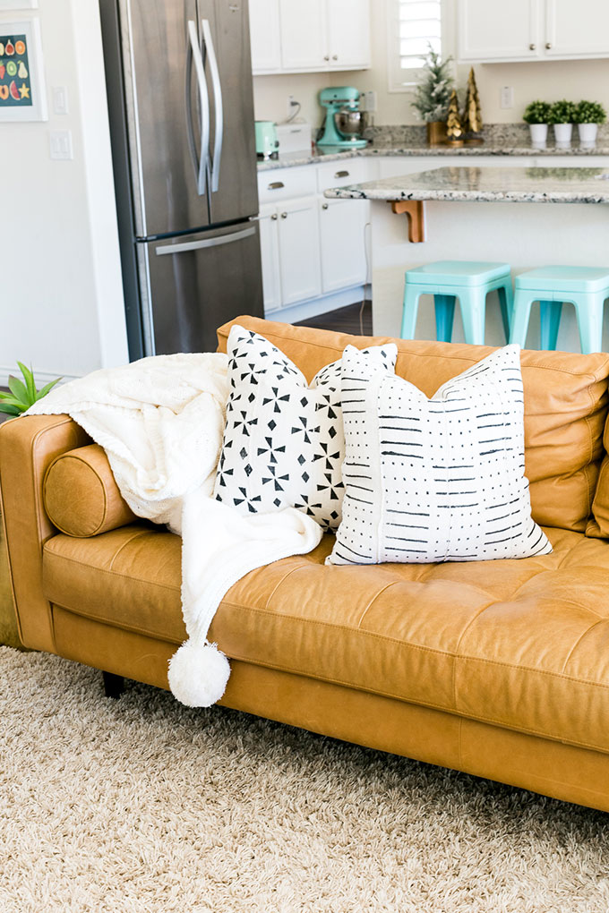 tan leather couch living room pictures with rugs why the sven sofa is perfect for in your one article charme white pom blanket and black throw pillows
