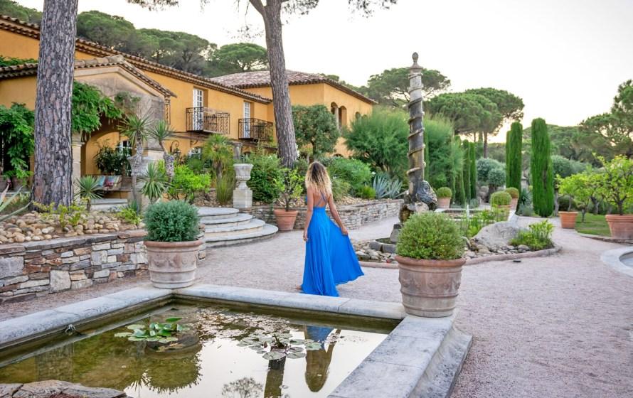 girl in blue dress next to fountain at Villa Marie Saint Tropez