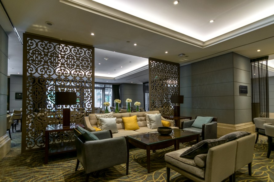 couches and tables in lobby at Corinthia Hotel Lisbon