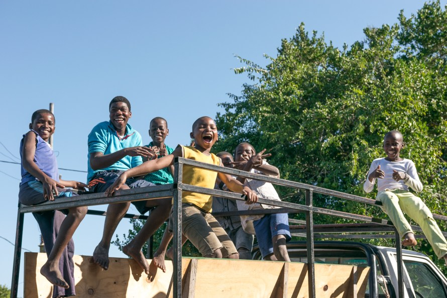 kids laughing on a truck in Mozambique