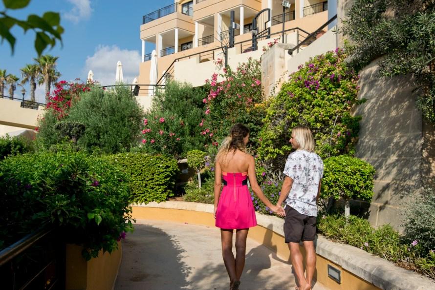 Travel couple at Corinthia Hotel St. George's Bay Malta