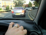 Queueingon the A25, wedding band showing