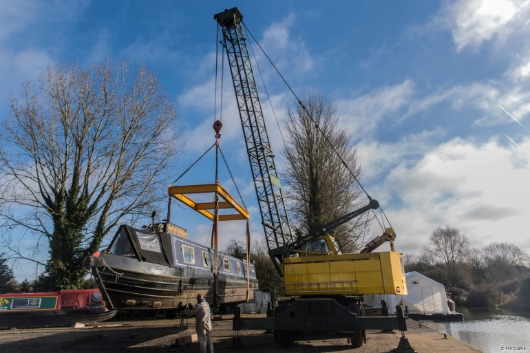 Crane at Aldermaston: Narrowboat being lifted out of the canal at Aldermaston Wharf.