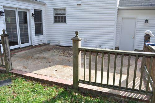 concrete patio with bluestone inlay