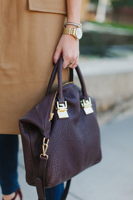 burgundy satchel with gold detail