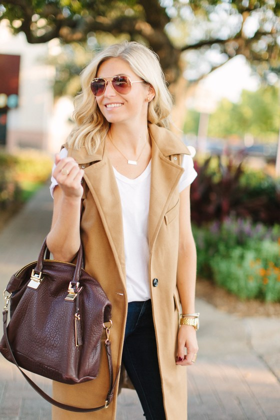 long sleeveless vest with white t shirt and burgundy satchel