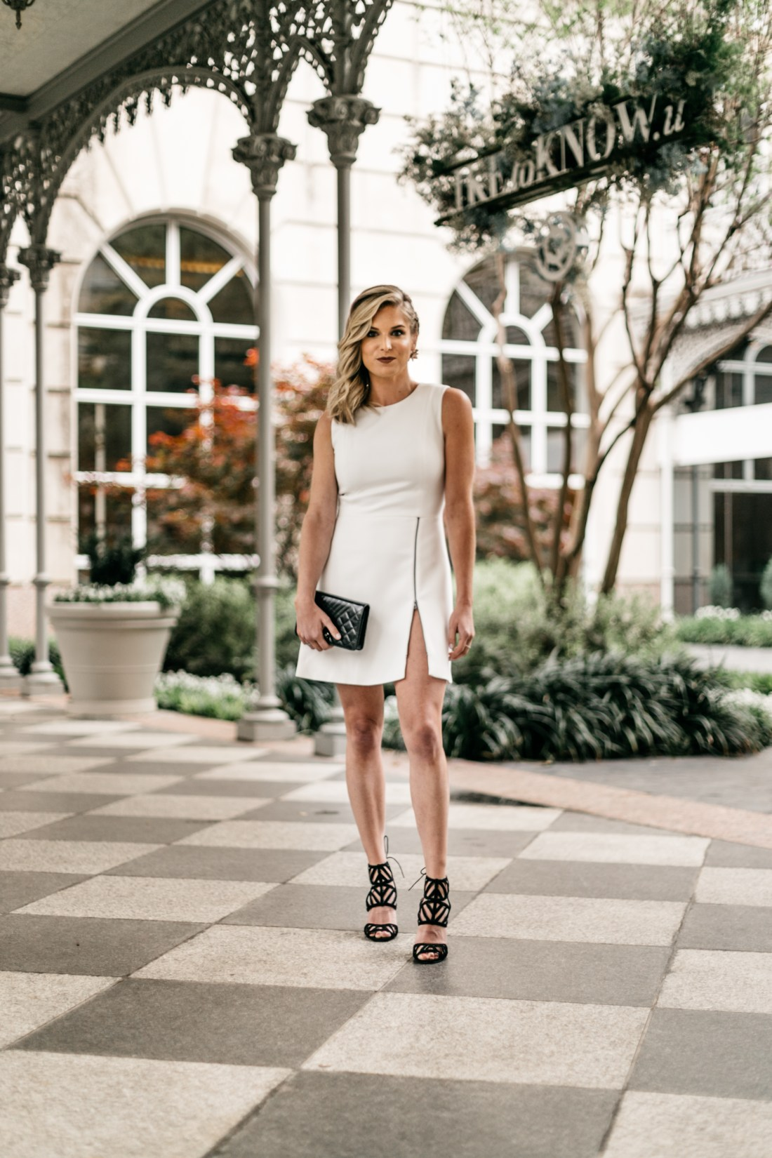 Outfit details: Black Clutch // White Sleeveless Dress with Zipper //Black Open Toe Heels