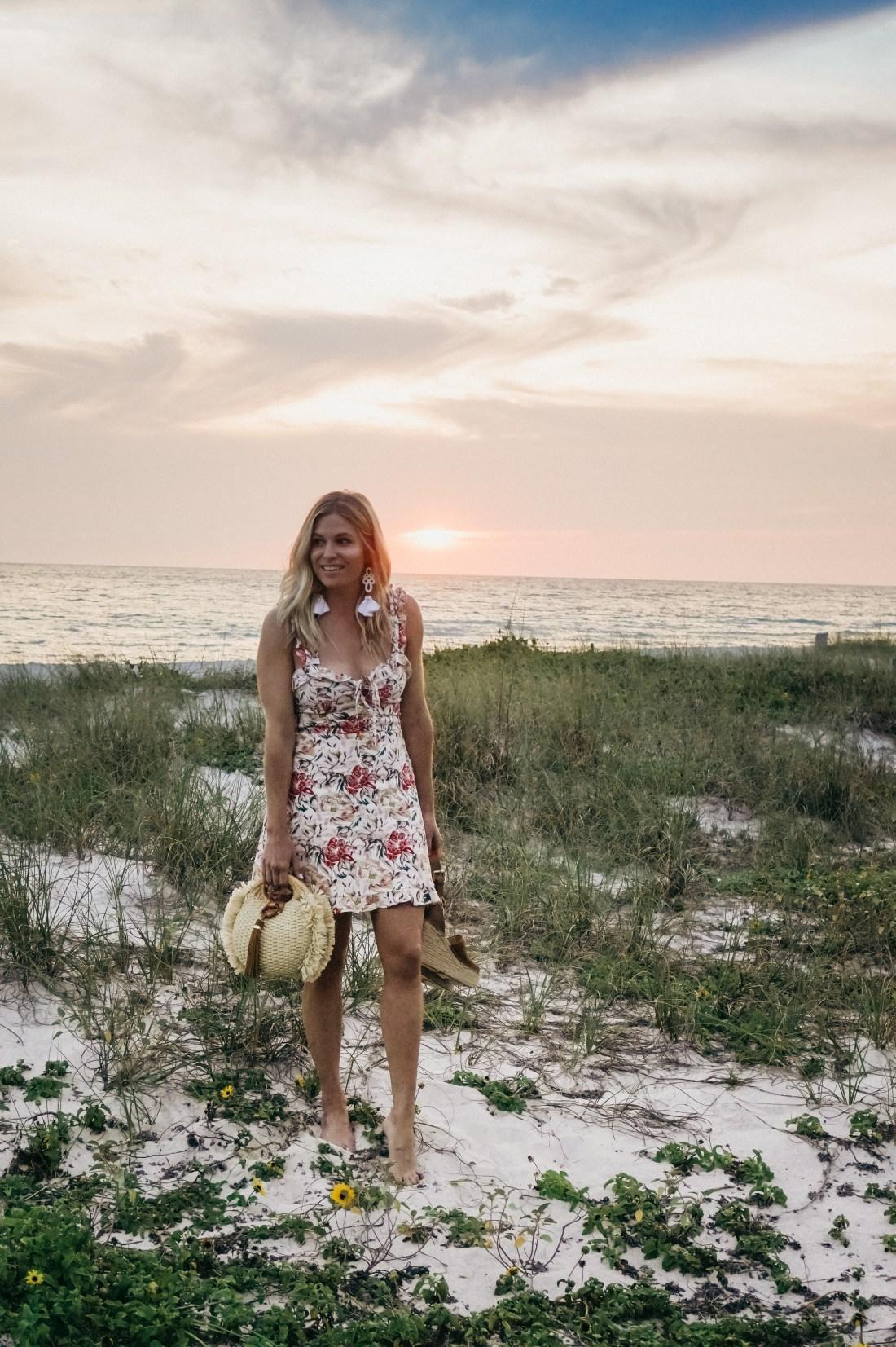 Brooke Burnett wearing floral mini dress on Florida beach