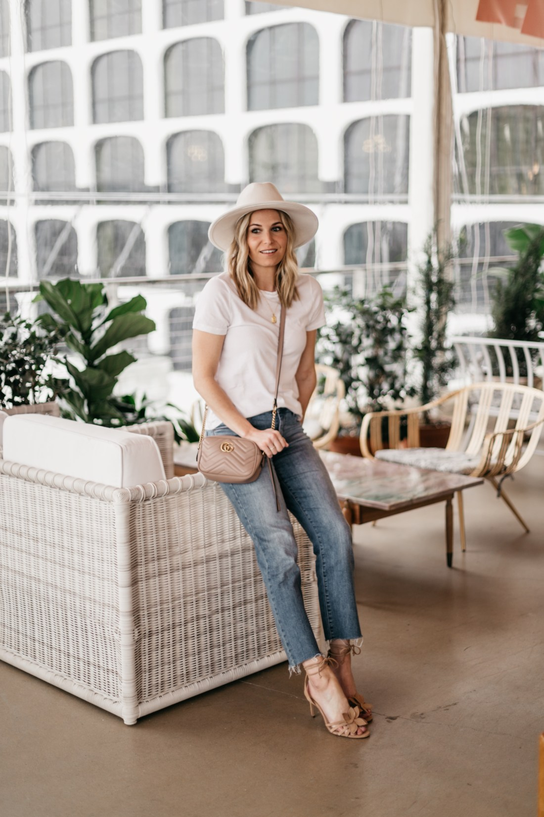 white hat and top, jeans, nude sandals and gucci bag outfit in Austin