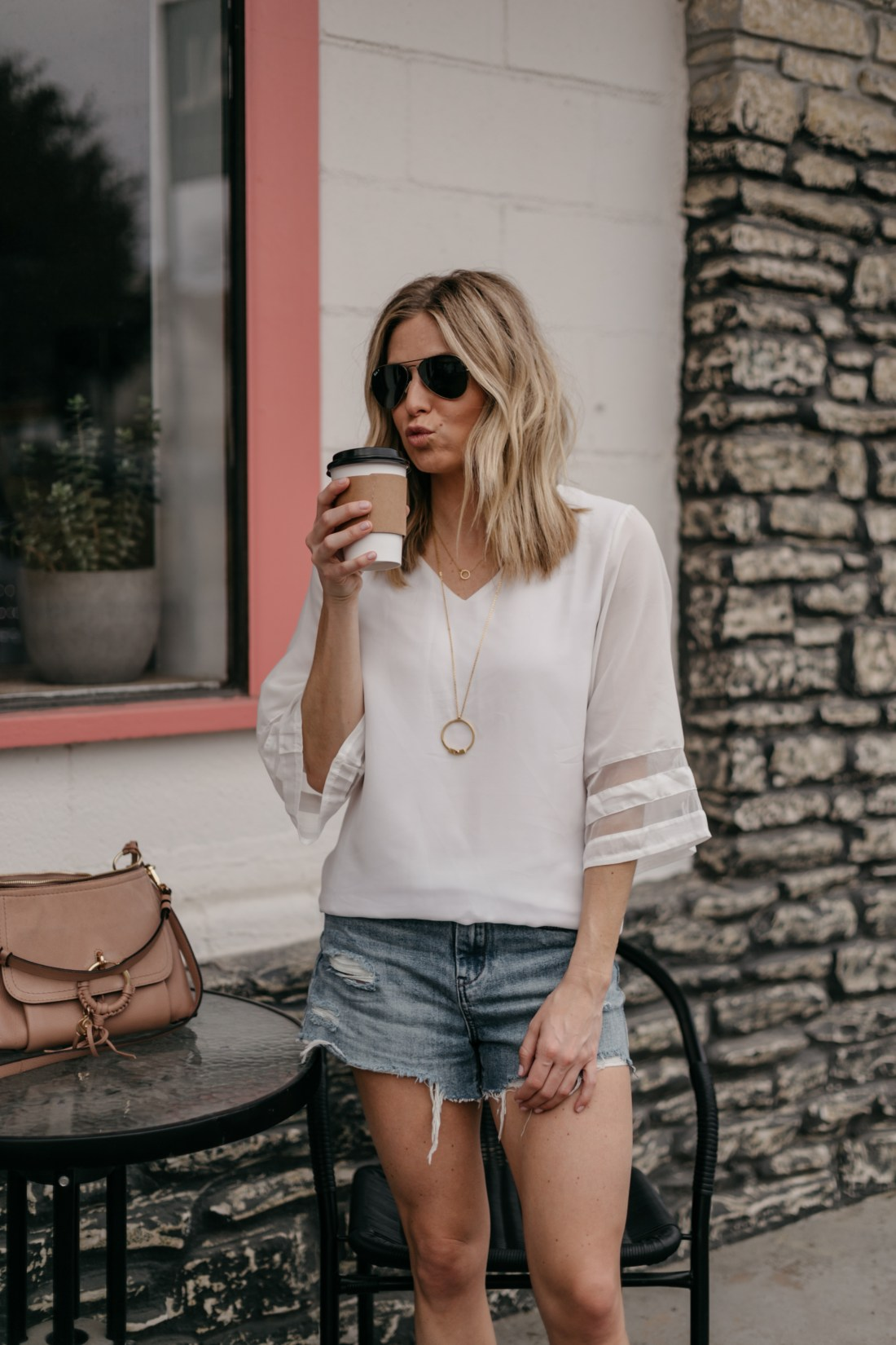 SXSW Austin -  white top and jeans shorts