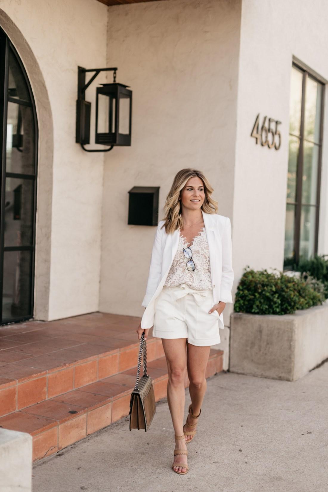 Brooke Burnett is wearing a preppy white outfit