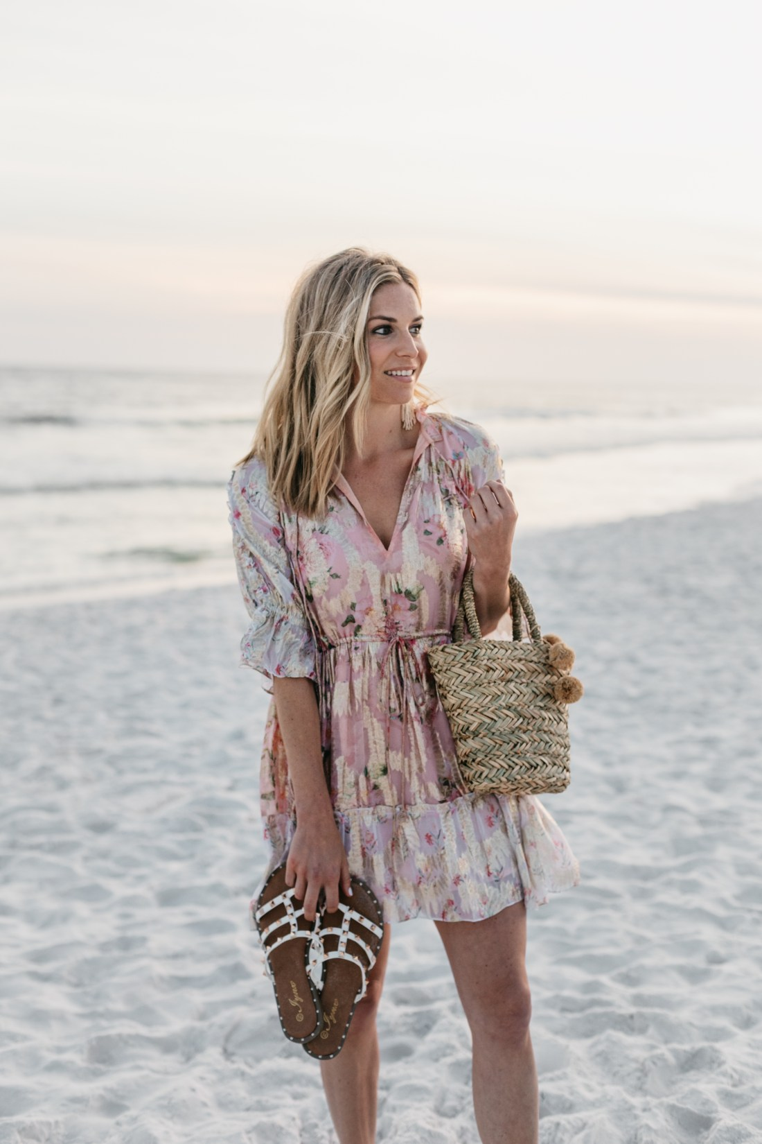 Brooke Burnett's outfit details: Blush Floral Dress // White Studded Sandals // Straw Bag // White Fringe Earrings