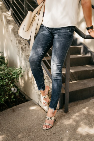 jeans, a blouse, and purse