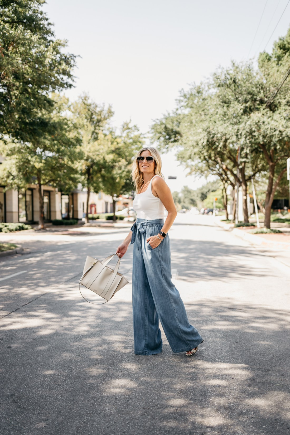 a summer outfit with blue pants