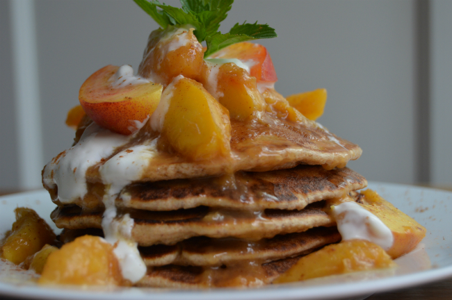 Pancakes with stewed peaches