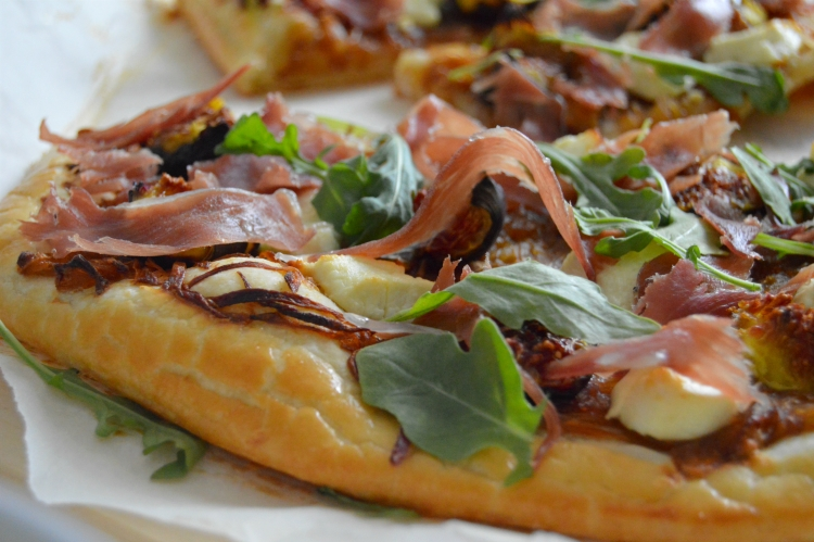 puff pastry tart with caramelized onions, figs, prosciutto, goat cheese and arugula