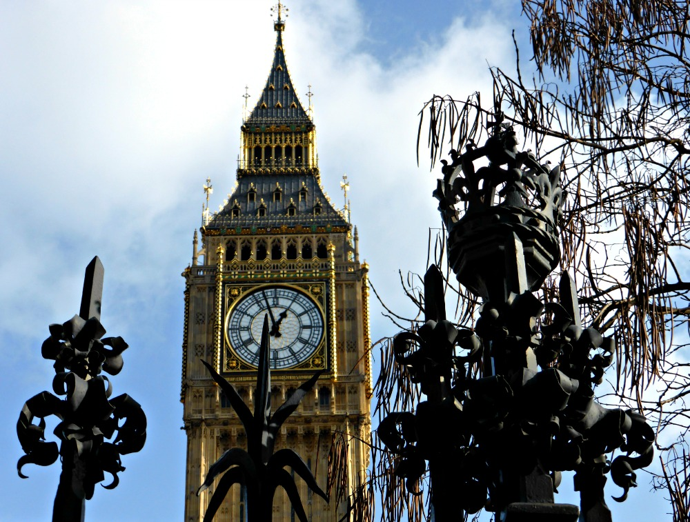 Big Ben behind the beautiful iron fence surround the Houses of Parliament