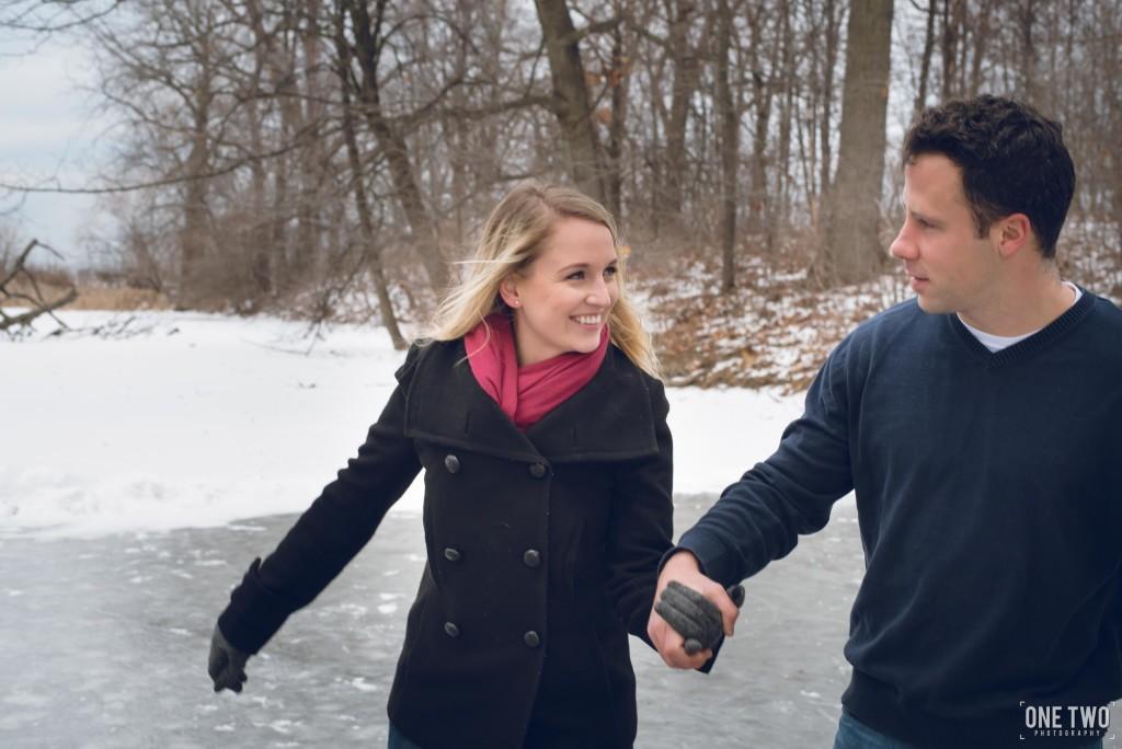 couple skating frozen pond