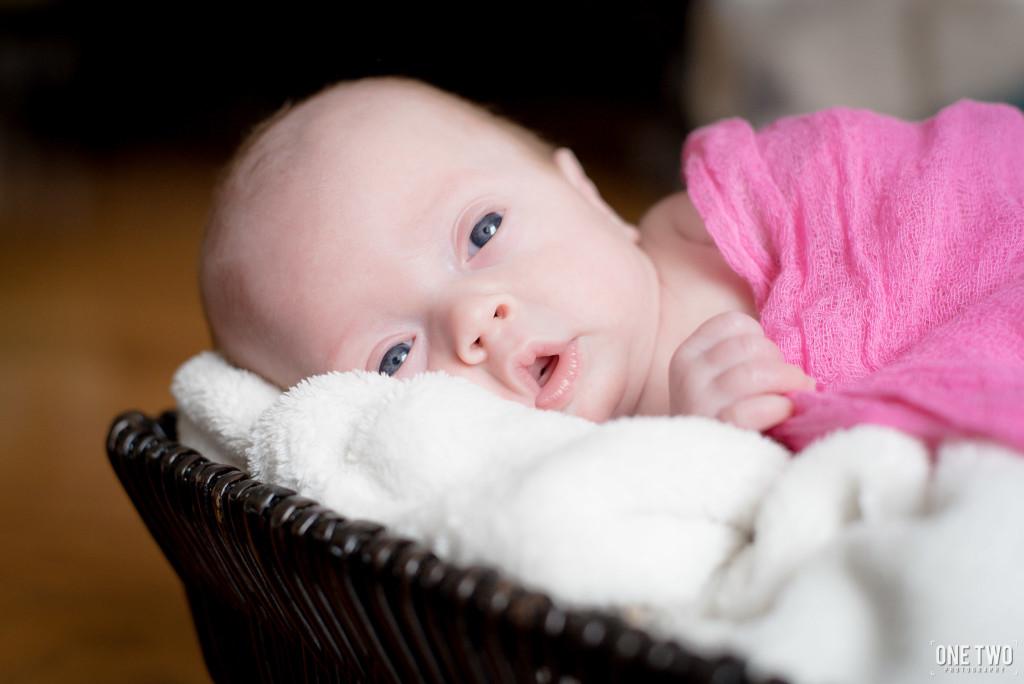 baby girl eyes wide open newborn photography