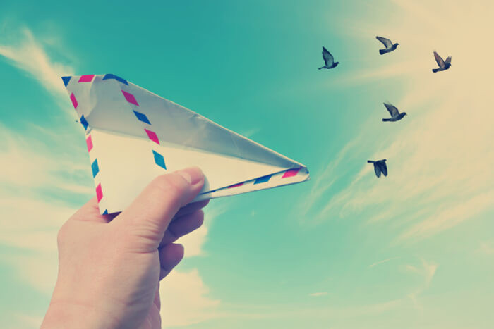 Paper plane in one hand