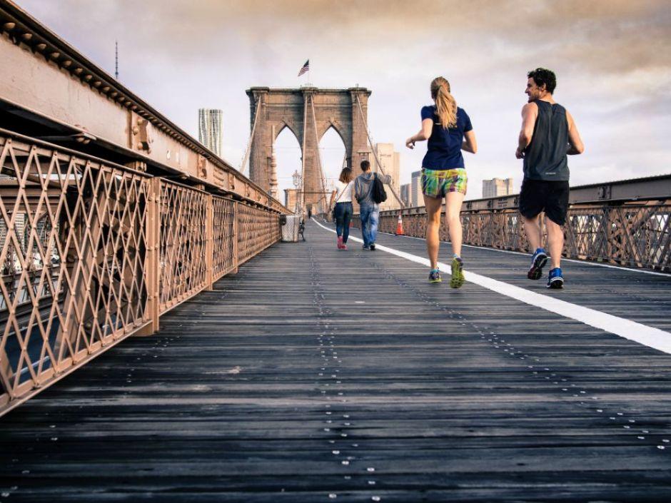 a couple run on a bridge (1)