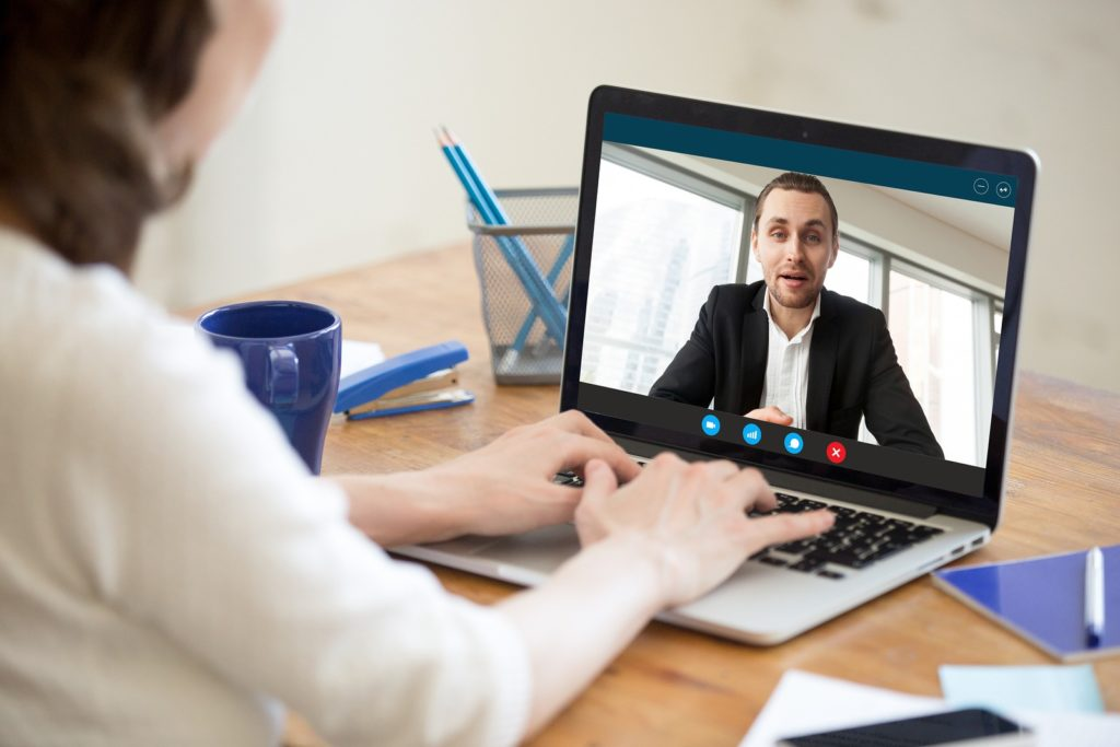 Businesswoman making videocall 1024x683 - Hire a Virtual Assistant: A Guide to Outsourcing & Hiring the Best