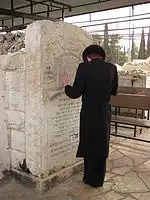 Praying_at_Belzer_Rebbe's_grave