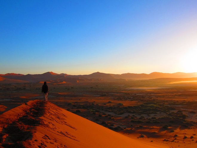 Hiking up on top of Big Daddy dune at dawn