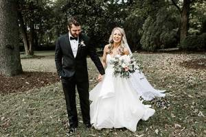 black tuxedo with bride in her white wedding gown