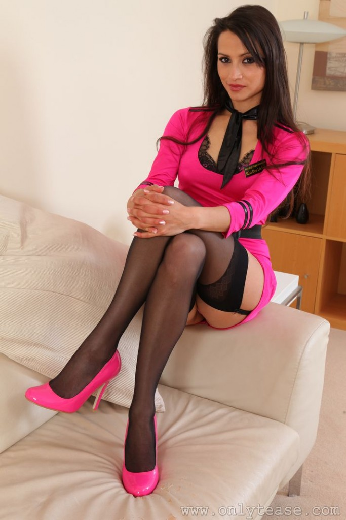 Only Tease Fan  Chelsea French poses in a flight attendant uniform and nylons