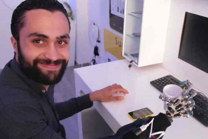 Mohamed Zied Cherif uses Smart Hand to pick up a coffee cup.