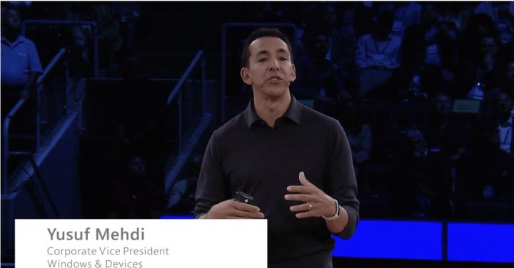 Yusuf Medhi wearing a white Microsoft Band at WPC 2016.