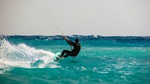 man doing kitesurfing