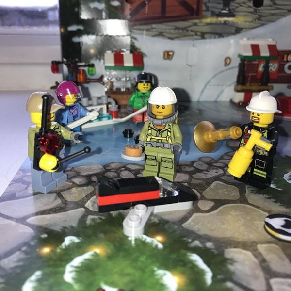 #legocityadvent Day 18: Bearded fireman & maintenance guy are not sure about the new gentleman who has arrived...why is he in breathing gear & what is he carrying...