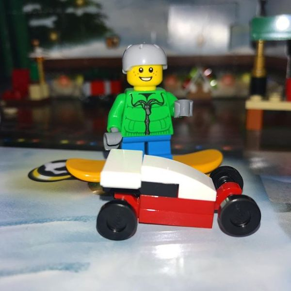 Today in #legocityadvent Snowboard boy is Happy with his toy car.