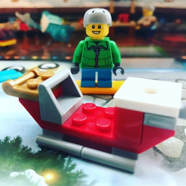Snowboard boy getting excited in #legocityadvent by the arrival of a sleigh but where is the big man himself?