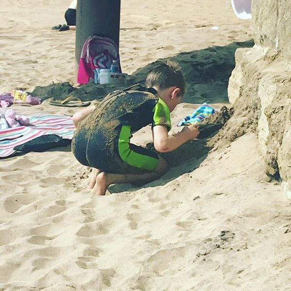Having had a dip & discovered yes you can swim in the sea now using shell to dig.... this is the boy when we met him who hated sand on him anywhere #adoptionjourney