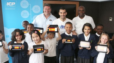 Children from Ashbury Meadows use the ICP Networks donated tablets for a Spanish lesson