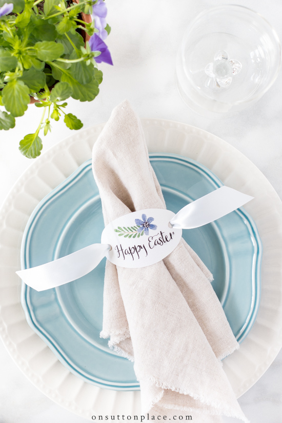 happy easter napkin ring with ribbon on blue plate