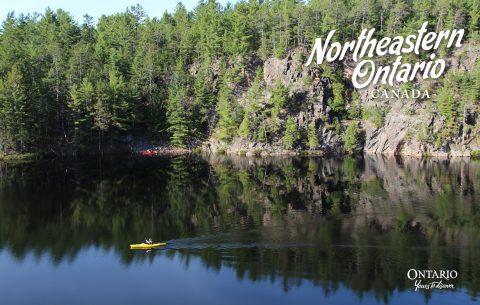paddler on lake in Northeastern Ontario