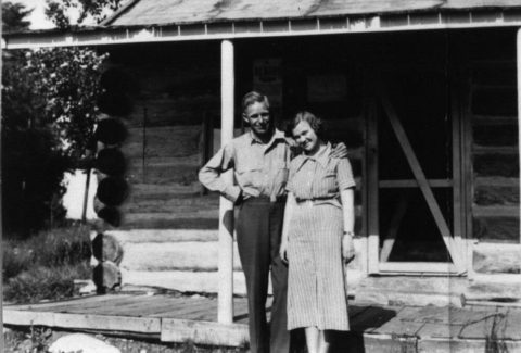 Jess and Kay Valley stand in front of a cabin